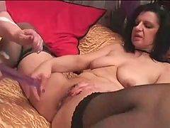 Naughty and adorable slut is inserting sex tool in...