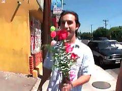 Guy presents pretty lady flowers and wants to get ...
